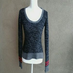 Energie black & grey sweater with red accents.